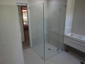 Frameless SHower Screen next to bathroom mirror
