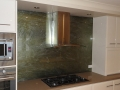 Kitchen glass splashback over a stove