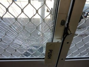 Smashed front door of office